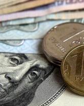 Доллар США потерял 18 копеек