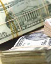 Во вторник доллар теряет 27 копеек