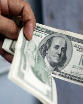 Доллар подорожал на 73 копейки