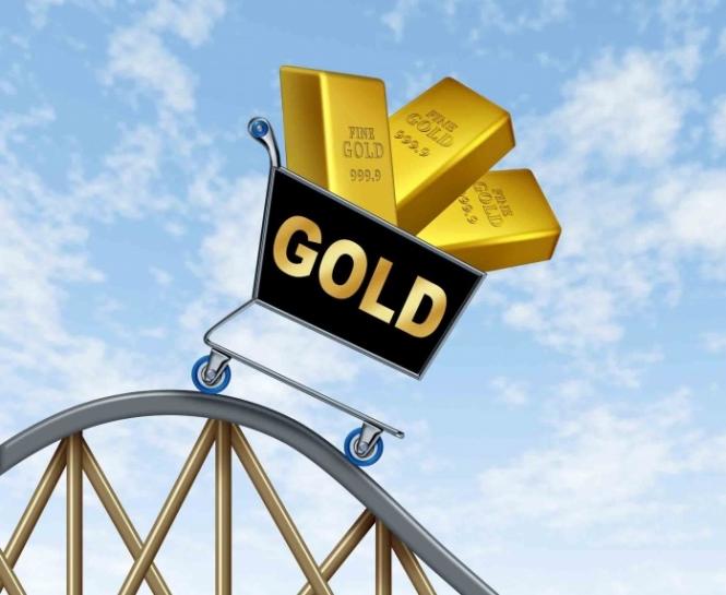 Цена золота снижается на фоне роста курса доллара США